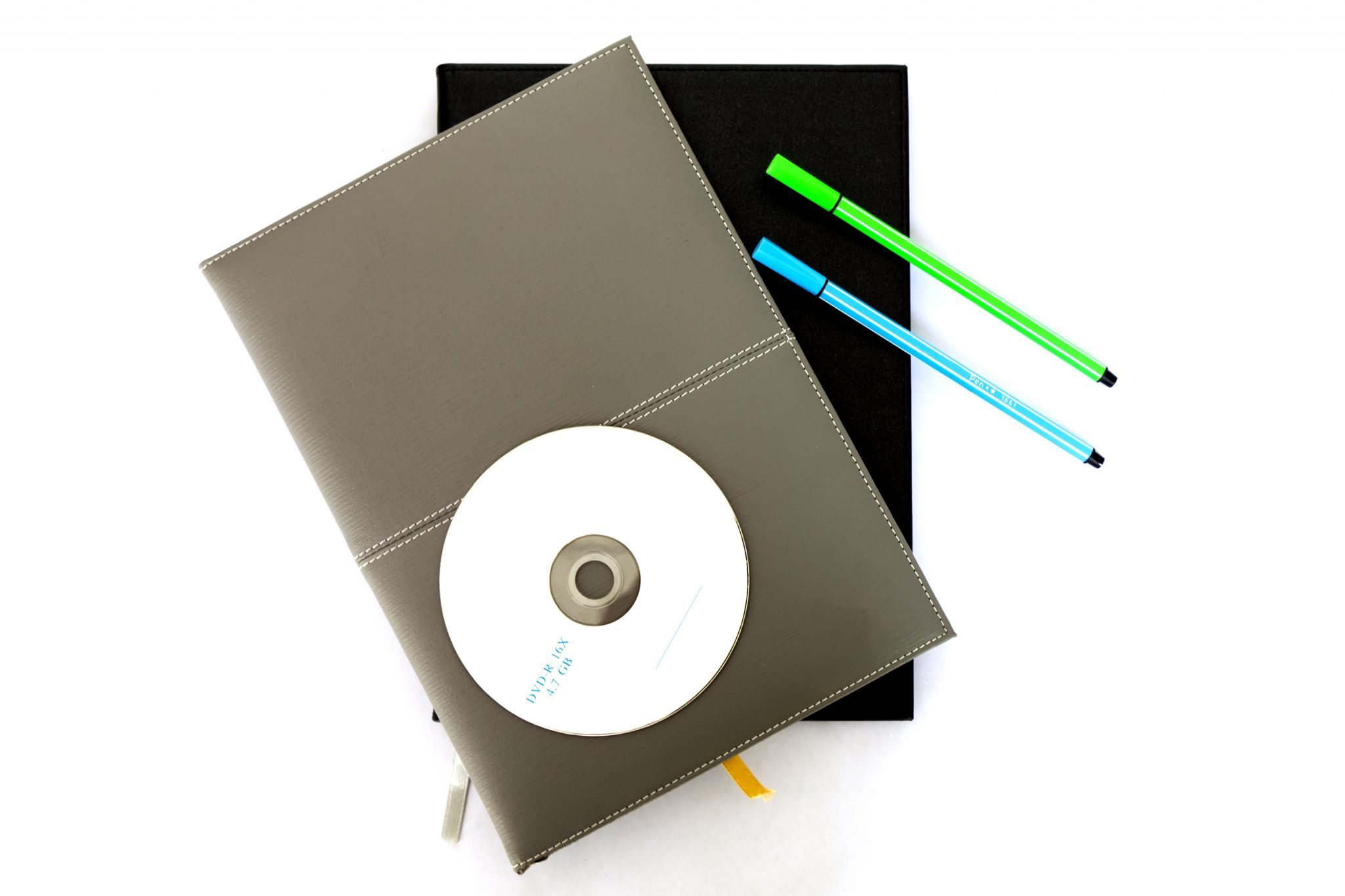 bigstock-Notebook--Pen--CD-21259127